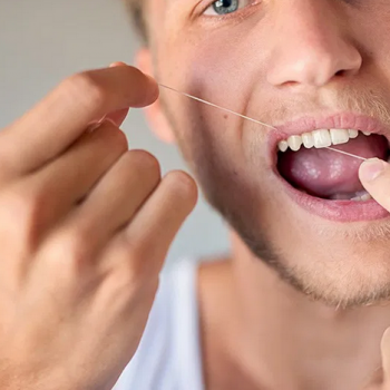 flossing your teeth